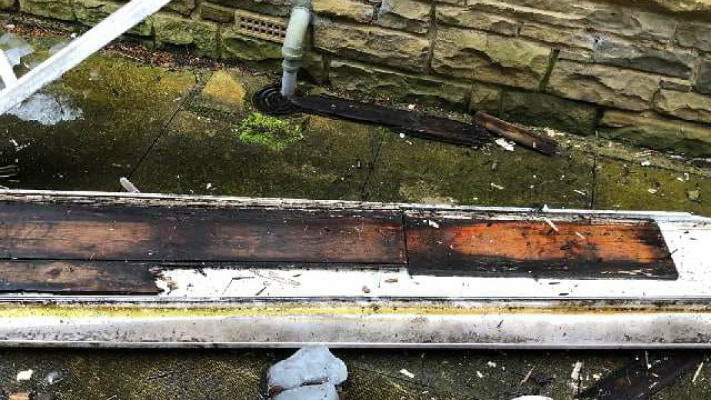 A Rotten Fascia Board that had been capped on a house in Denby Dale Wakefield West Yorkshire
